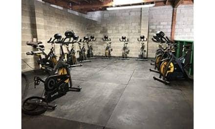 Eco-Friendly Fitness Studio Incorporating SportsArt ECO-POWR Spinning Bikes