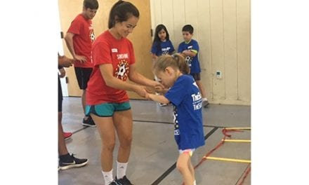 University of St Augustine Students Volunteering at Sunshine Soccer Clinic