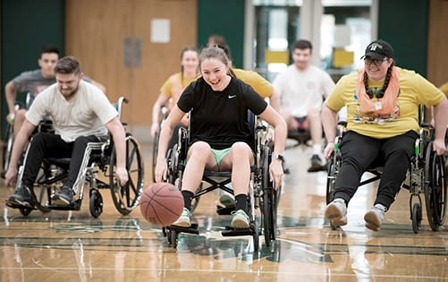 Husson University Students and Alumni Compete in Wheelchair Basketball