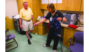 Mary Free Bed patient John P. Smith works with the Neuroeducator 4 surface EMG biofeedback to help him get maximal volitional signal from the anterior  tibialis while stepping forward.