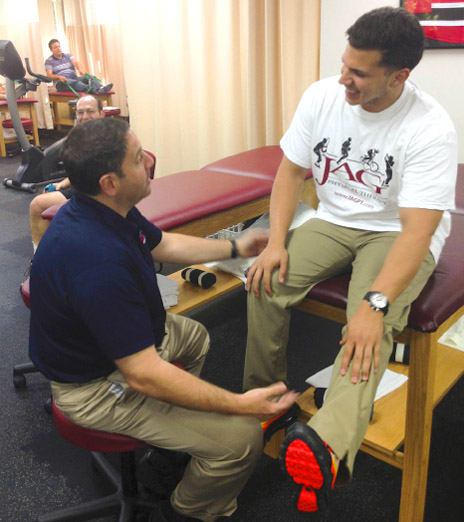 Author consults with a patient about concussion signs and symptoms after injury.