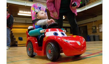 Shown here is a toddler using a Go Baby Go modified toy car. (Photo courtesy of Oregon State University)