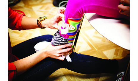 Physical therapist adjusts the strap on an AFO designed for pediatric use to ensure proper positioning.