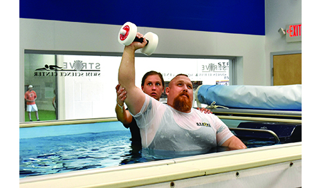 Therapist works with a patient s/p right THA with multiple complications postop.  The pool allows work on both legs with varying degrees of intensity given the very different situation each hip presents. Therapist guides PNF patterns to work on full-body flexibility and lower extremity stability and balance.