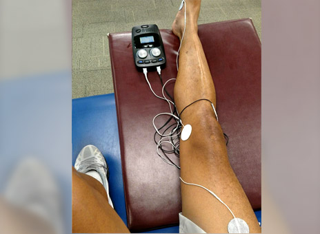 H-Wave electro therapeutic treatment in use with patient at Orthhcarolina clinic.