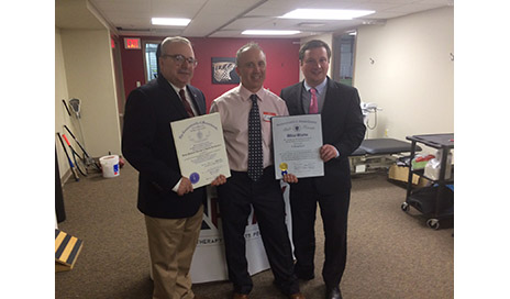 Massachusetts State Representative David DeCoste (R-Norwell) (left) and Massachusetts State Senator Patrick O'Connor (D-Weymouth) (right) presented Eric Edelman (center), owner of Peak Physical Therapy & Sports Performance, with commendations from the state legislature congratulating Peak on its newest location.