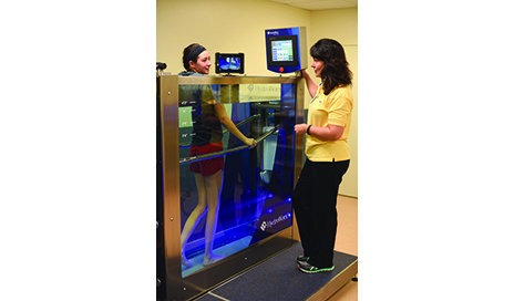 Cheryl Ogran, MSPT, CLT-LANA, adjusts the water level for a patient in Mercy Fort Scott's new HydroWorx 300 Series.