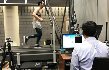 Researchers test the performance of a runner who is wearing compression tights. (Photo courtesy of The Ohio State University Wexner Medical Center)