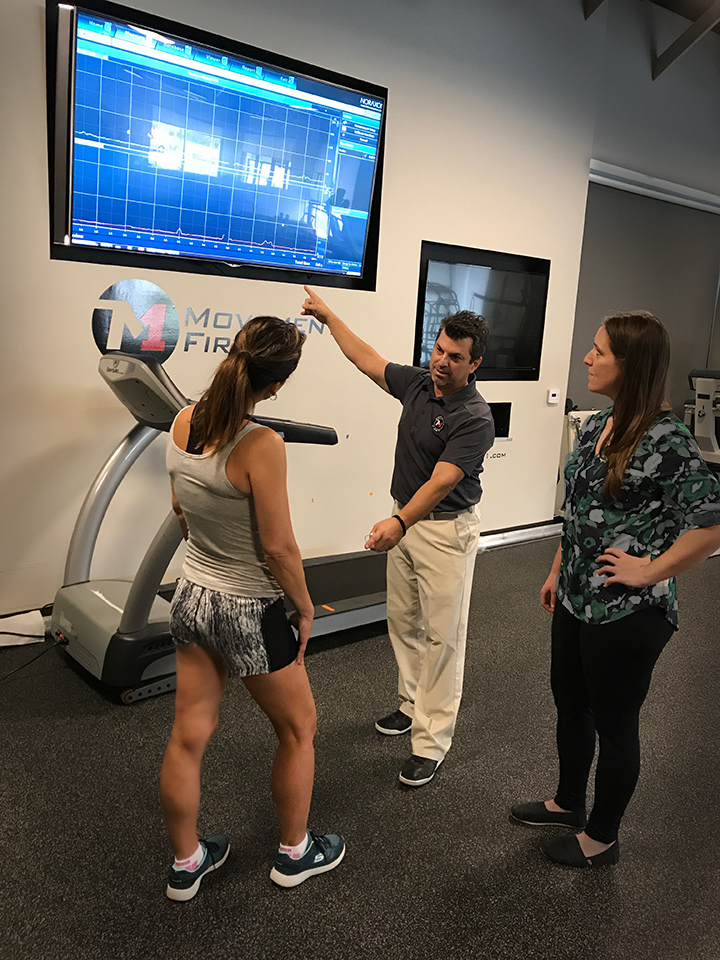 Therapists discuss implications of movement data to adjust the client's running mechanics.