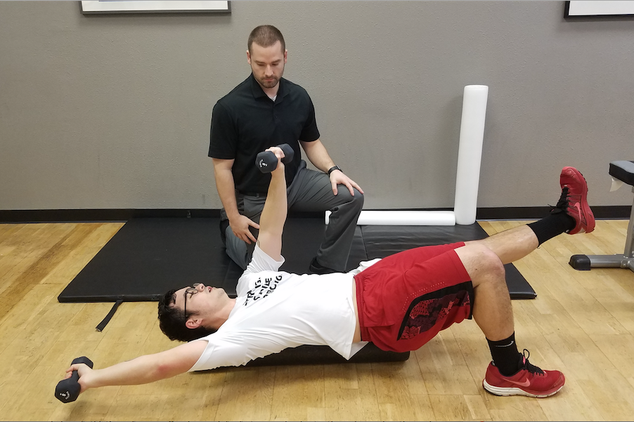 Brian Blevins, DPT, works on strength and conditioning with an athlete-client at Stride Strong Physical Therapy.