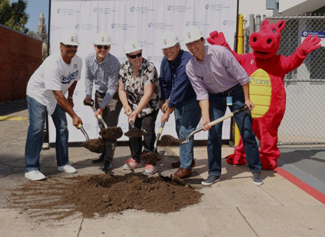 """Orthopaedic Institute for Children (OIC) broke ground on a new urgent care center September 23 in Los Angeles. Participating in the festivities were (from left) former Dodgers pitcher Dennis Powell, OIC foundation board trustees Jeff Prestine and Chris Wright Roper, OIC Medical Director Dr Mauricio Silva, OIC President and CEO Dr Anthony Scaduto, and OIC's mascot, """"Ozzie."""" (Photo courtesy of Business Wire)"""
