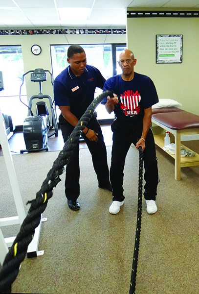 Stephen G. Linton, PT, DPT, guides PTW client, Bill, in using Titan Battle Ropes to elevate his dynamic core and hip stability, gait pattern, posture, ambulation endurance, and functional lifting abilities. At the time of this session, Bill is approaching discharge from therapy after weeks of  progressive interventions improving his prone resting and standing posture limited by his hip flexure contracture and hip joint anterior adhesions.