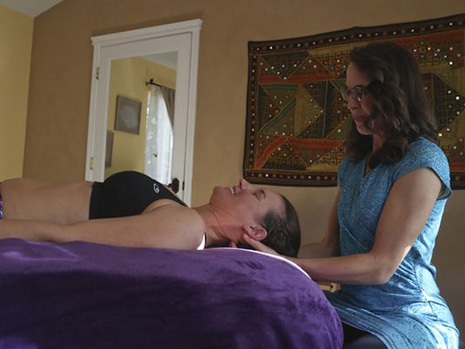 Diana Burkholder, right, performs a Rolfing technique on one of her patients. (Photo courtesy of Greg Barnette/Record Searchlight)
