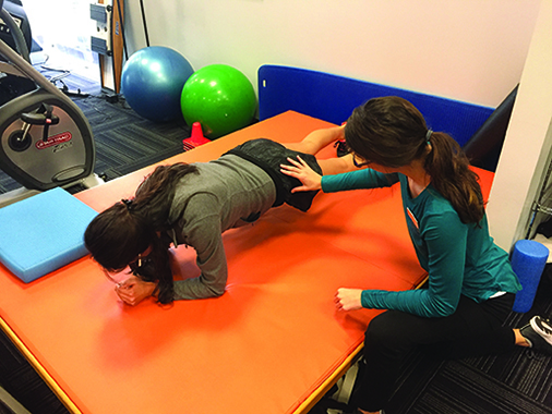 Michelle works on improving her strength and neuromuscular control as she  performs a plank. She is able to resist sight pressures improving her neuromuscular control of abdominal and lower quarter musculature.