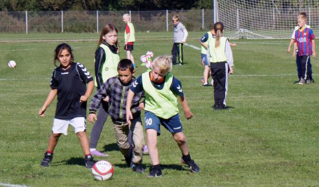 Schoolchildren participating in the FIT FIRST study are shown playing soccer. The FIT FIRST Study suggests that ball games and circuit training could help strengthen bones, as well as increase strength and improve balance, among schoolchildren. (Photo courtesy of F-MARC)