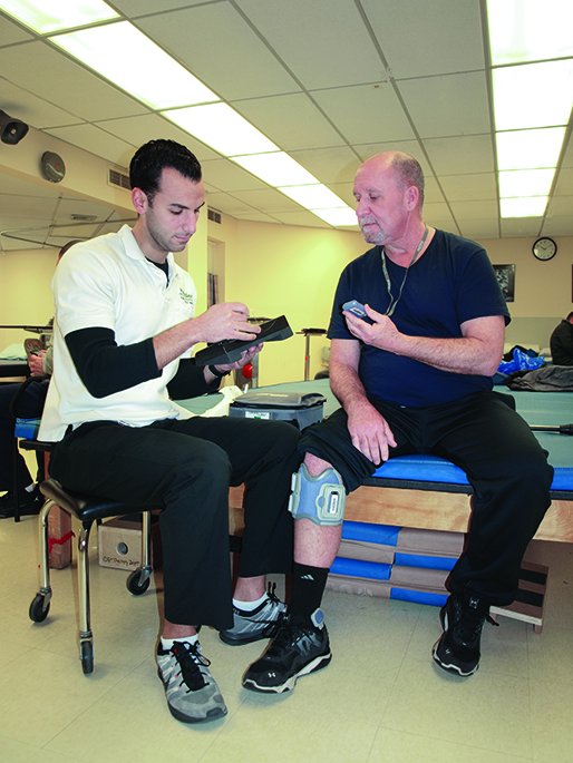 A therapist and patient discuss features of a lower extremity functional electrical stimulation device. The patient's understanding of the benefits advanced technology can provide is crucial to enhance the individual's engagement in usage of these interventions.