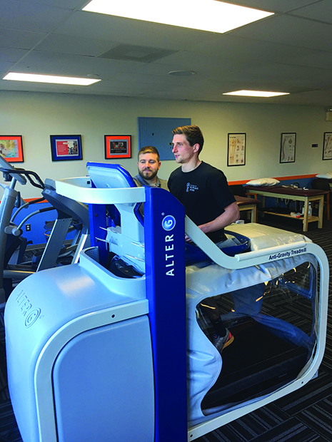 Brandon Lewandowski, DPT, clinical director of the Physical Therapy & Wellness Institute's Horsham, Pa, office, works with a patient to rehab a high ankle sprain. By using the AlterG Anti-Gravity treadmill, therapists ensure that patients can return to normal activities without putting too much pressure back on the injured ankle.